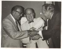 Fort Lauderdale realtor George E. Mayer (center) is welcomed to the board of trustees in 1969