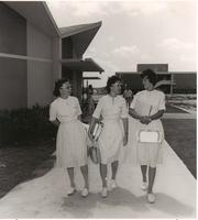 Nursing students chat as they stroll