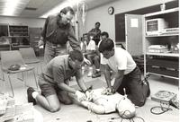 Prof. Joe Jones directs students in the paramedic and emergency medical technology programs